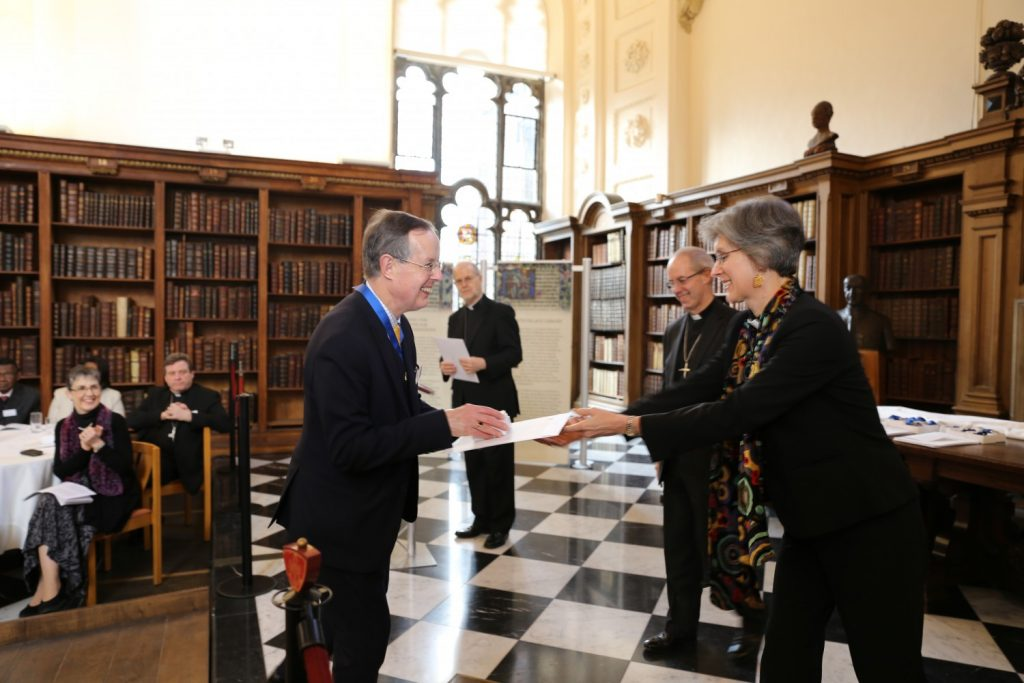 Dr James Lancelot receiving his award