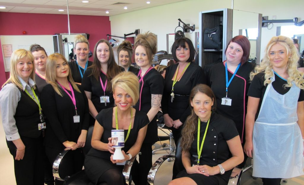 Alison and staff and students from the East Durham College hair and beauty department