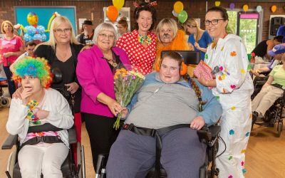 Adults with disabilities treated to circus themed celebrations at summer funfair