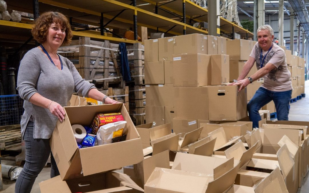 Council staff prepare food parcels to help vulnerable people across the county