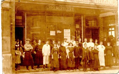 Do you know the location of the shop and people in this photograph?