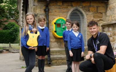 Housebuilder donates defibrillator to Wingate community following school campaign
